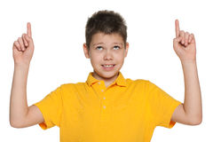 Cheerful boy showing his fingers up Stock Image