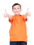Cheerful boy showing thumbs up gesture. Portrait of cheerful boy showing thumbs up gesture - isolated over white Royalty Free Stock Image
