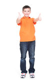 Cheerful boy showing thumbs up gesture. Portrait of cheerful boy showing thumbs up gesture - isolated over white Stock Photography