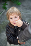 Cheerful boy showing thumbs up. royalty free stock image