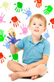 Cheerful boy sitting with hand painted Royalty Free Stock Photos