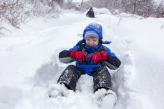 Cheerful boy sledding Royalty Free Stock Images