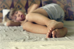 Cheerful boy sleep. In the bed Royalty Free Stock Images