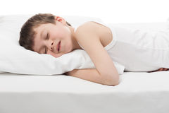Cheerful boy sleep in bed. Cheerful boy sleep in white bed Stock Image