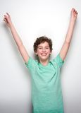 Cheerful boy smiling with hands raised Stock Images