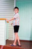 Cheerful boy standing on the porch Stock Photo