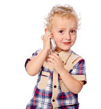 Cheerful boy talking on the phone. Portrait of a cheerful boy talking on the phone on a white background stock images