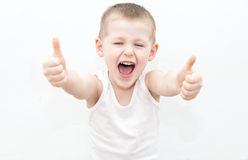 Cheerful boy with thumbs up stock images
