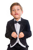 Cheerful boy in a tuxedo. Stock Image