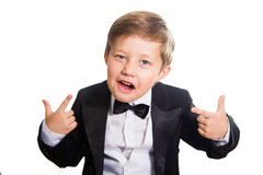 Cheerful boy in a tuxedo. Royalty Free Stock Photos