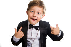 Cheerful boy in a tuxedo. Royalty Free Stock Photo