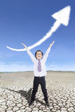 Cheerful boy and upward arrow Royalty Free Stock Images