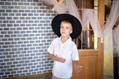 Cheerful boy wearing new wizard hat royalty free stock image