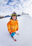 Cheerful boy wearing ski mask and helmet skiing Royalty Free Stock Images