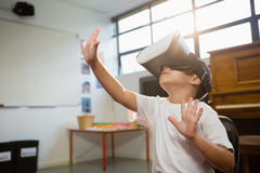 Cheerful boy wearing virtual reality simulator while sitting at home Stock Photo