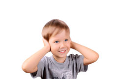 Cheerful boy 5 years shut by the hands ears. Horizontal Image isolated on white background Stock Photos