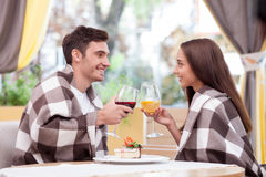 Cheerful boyfriend and girlfriend are dating in Royalty Free Stock Photo