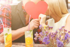 Cheerful boyfriend and girlfriend dating in cafeteria Stock Photography