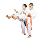 Cheerful boys athletes train beat blows kicks Stock Images