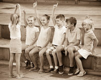 Cheerful boys and girls   playing charades Stock Image
