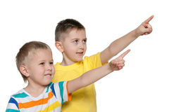 Cheerful boys pointing aside Stock Images
