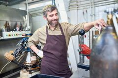 Cheerful Brewer at Work Royalty Free Stock Image