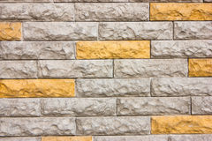 Cheerful brick wall Stock Photos