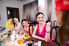 Cheerful bride and bridesmaids celebrating hen party with drinks Royalty Free Stock Photo