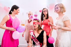 Cheerful bride and bridesmaids celebrating hen party with drinks. Cheerful bride and happy bridesmaids celebrating hen party with drinks. Women enjoying a Royalty Free Stock Photo