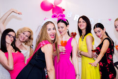 Cheerful bride and bridesmaids celebrating hen party with drinks. Cheerful bride and happy bridesmaids celebrating hen party with drinks. Women enjoying a royalty free stock images