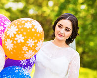 Cheerful bride  with bunch of balloons Royalty Free Stock Photo