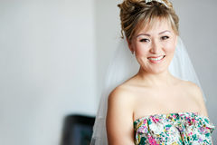 Cheerful bride in casual clothes with veil during preparation for wedding, copy space. Royalty Free Stock Photos