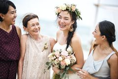 Cheerful bride with family at the beach royalty free stock photos