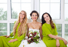 Cheerful bride with female friends stock images