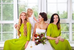 Cheerful bride with female friends and little flower girl Royalty Free Stock Images