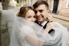 Cheerful bride and groom hugging face closeup, newlywed couple s Stock Images