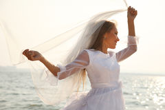 Cheerful bride near water Royalty Free Stock Photo