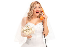 Cheerful bride talking on telephone Royalty Free Stock Photography