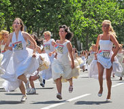 Cheerful Brides during the traditional Street Race in Belgrade Stock Photos