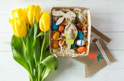 Free Cheerful, Bright, Sunny And Colorful Easter Decorations For Home. Everything Is Ready To Celebrate: Eggs, Flowers, Paints, Banner Royalty Free Stock Images - 132044159