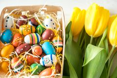 Cheerful, bright, sunny and colorful Easter decorations for home. Everything is ready to celebrate: eggs, flowers, paints stock image
