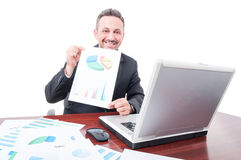 Cheerful broker showing investment results Stock Images