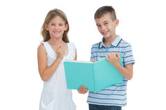 Cheerful brother and sister learning their lesson together Royalty Free Stock Image