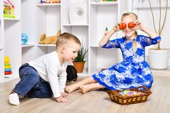 Cheerful brother and sister playing in the Easter royalty free stock images