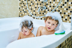 Cheerful brother and sister together take water treatments Stock Image