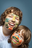cheerful brothers with painted faces Royalty Free Stock Photos