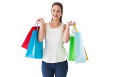 Cheerful brown hair holding shopping bags Stock Photo
