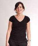 Cheerful brunette in black Stock Photography