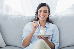 Cheerful brunette eating egg Royalty Free Stock Photo
