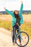 Cheerful brunette girl during cycling Royalty Free Stock Image
